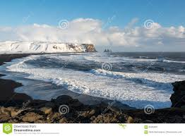 beaches with black sand winter landscape with reynisdrangar stacks black sand beach and