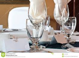 water glasses on table setting wedding table place setting with blank place card stock photo