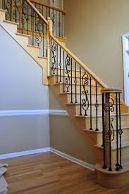 Wood Banisters And Railings Iron Balusters To Fix Our Stairs For The Home Pinterest
