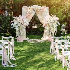 arch decoration wedding arch decorated with cloth and flowers outdoors beautiful