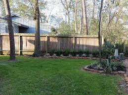 the back yard is partially fenced in but it would be simple to