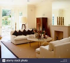 Cream Sisal Rug Cream Sofas Facing Each Other Over Coffee Table In Front Of