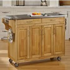 cabin creek kitchen island with breakfast bar and two stools in a