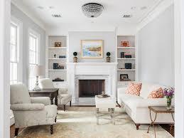Living Room Recessed Lighting Abstract Art City Views Recessed Lighting Beige Area Rug Gray Sofa