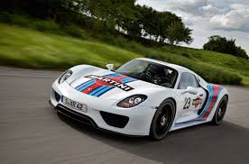 porsche 918 spyder at nurburgring in a martini suit