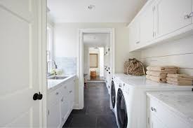 white laminate flooring laundry room traditional with white
