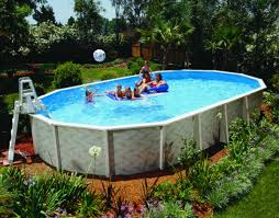 swimming pool round above ground pool with foliages around the
