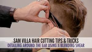 detailing around the ear with a blending shear men u0027s haircut