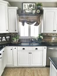 sinks black knobs white paneled cabinets cottage style kitchen