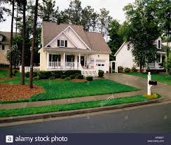 Small Two Story House Small Two Story Cream House With Black Shutters White Trim And A