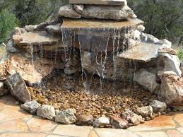 rock diy water fountain idea for small backyard garden