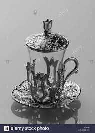 empty cup of tea tea cup with traditional arabic ornaments on white