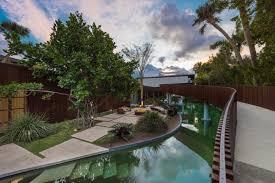 design house miami fl a miami beach home with a swimmable lagoon design milk