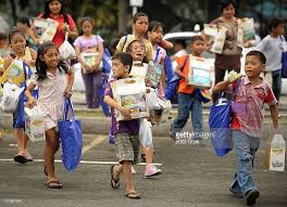 children carry gifts recieved during an pictures getty images