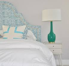 blue arched headboard with white mid century nightstand