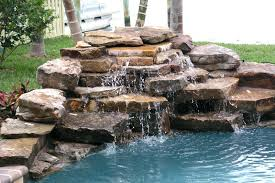 rock waterfalls for pools swimming pool waterfalls pictures home pools with a waterfall