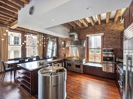 classy open plan apartment kitchen with exposed wood beams and