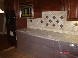 tiles backsplash black granite countertops with cream cabinets