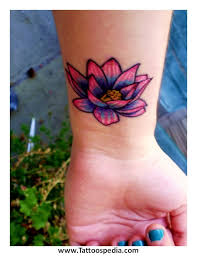 colored flower tattoos lotus flower lower back 2