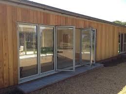 Okna Patio Doors Ral 7032 Bi Folding Aluminium Doors In Norfolk Okna