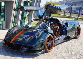 blue pagani pagani huayra bc in green carbon and bits of orange is impressive