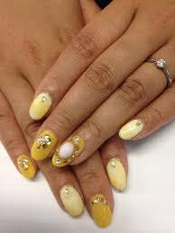 mustard yellow base moroccan nail design japanese nails