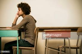 Picture Of Student Sitting At Desk Student Sitting At A Desk In A Classroom Stock Photo Getty Images