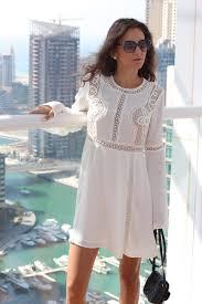 wear a casual white bell sleeve dress irinici