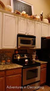 decorating ideas for kitchen cabinet tops best 25 above cabinet decor ideas on cabinet top