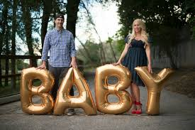 gold letter balloons pregnancy announcement status