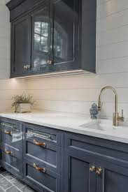 using high gloss paint on kitchen cabinets leather and unlacquered brass hardware on high gloss