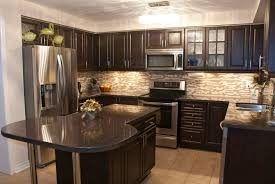 beige wooden laminate countertop antique white kitchen cabinets