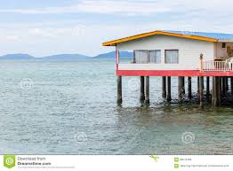 a house on stilts over water stock photo image 58576403