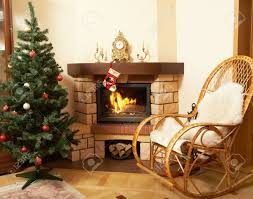 image of house room with rocking chair christmas tree fireplace