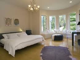 contemporary master bedroom with cowhide rug u0026 chandelier in