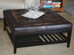 saving small lliving room spaces with black leather tufted ottoman