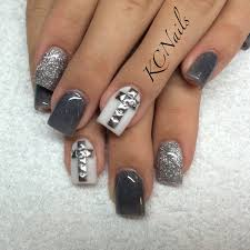 silver grey and white acrylic nails silver studded cross nails