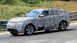 new land rover defender spy shots land rover range rover sport coupe spied on track