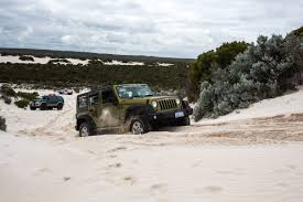sand jeep wrangler stuck in sand 4 wheel driving