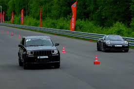 turbo jeep srt8 watch a jeep srt8 blast past a porsche turbo in a drag race