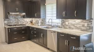 brown quartzite kitchen counter with dark cabinets