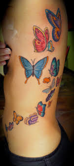 many colorful various butterflies om back tattoos pm