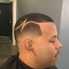 fade haircut with part designs