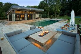 modern fire pit outdoor lounge and pool house outdoor spaces