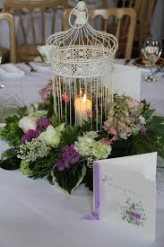 love bird cages on the table i like the dynamic arrangement and