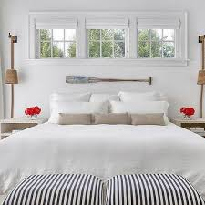 cottage bedroom with white linen nightstand cottage bedroom