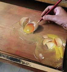artist creates realistic drawings on wooden boards