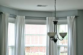 amusing curtain rods for bay windows with white drapes beautiful
