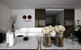 The Circular Dining Room by Table Lamp That Emphasizes The Circular Fluorescent Light