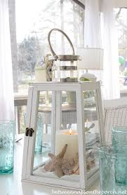 Beach Centerpieces Beach Table Setting With Lighthouse Lantern Centerpiece More